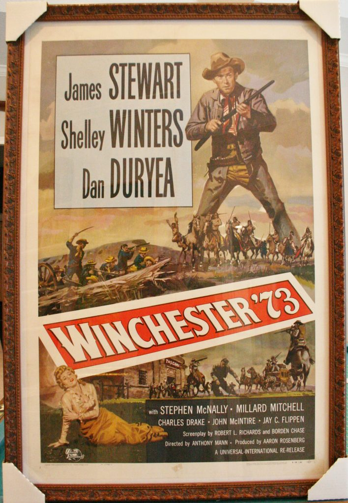 In this western poster the warm brown hues are picked out by this classic brown frame (Molding # 4570)